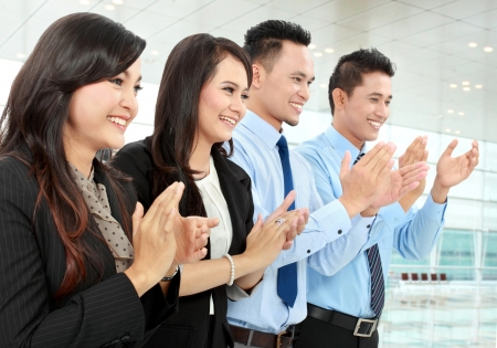 Portrait of a woman and man office workers  clapping celebrating success in the office Stock Photo - 17064786