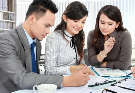 asian office lady: business man and woman working on the table in the office Stock Photo