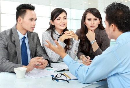 job evaluation: business man and woman meeting in the office