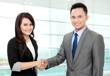 Shaking hands of two business people in the office photo
