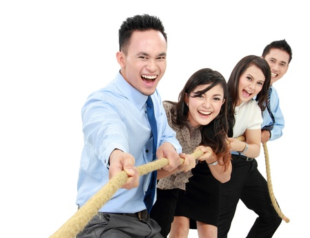 Business competition teams struggling to win. pulling rope on white background photo