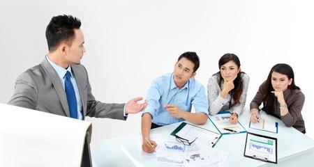 businessman giving a presentation to business team
