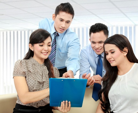 Portrait of successful business team discussing a monthly report Stock Photo - 17496252