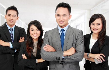 asian office lady: Portrait of a woman and man office workers with arm crossed in the office Stock Photo
