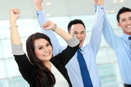 indonesian woman: Excited group of business people celebrating success Stock Photo
