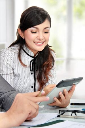 success businesswoman using tablet pc while meeting photo