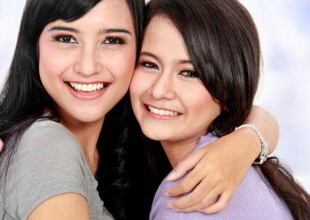 young beautiful woman embrace each other photo