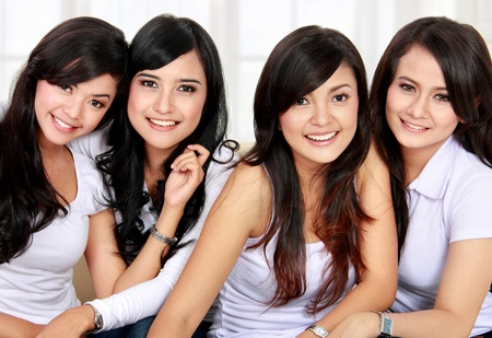 Group of beautiful asian women smiling together photo
