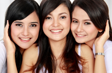 close up portrait of three beautiful asian woman in white photo