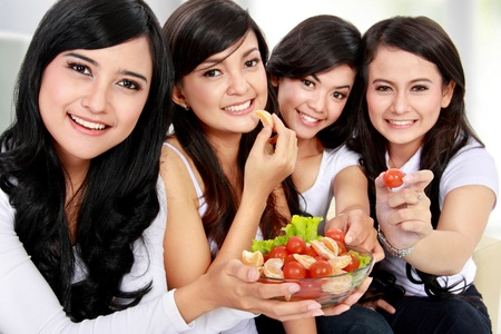 healthy lovely group of woman having fresh salad together photo