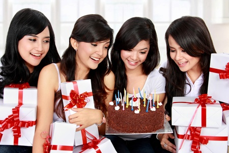 four young beautiful woman celebrate birthday photo