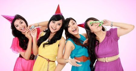 four friends: four young beautiful girls celebrate birthday isolated over white background Stock Photo