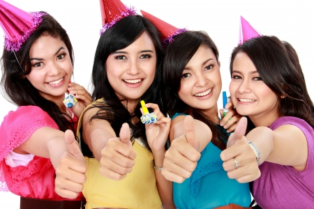 anniversary sexy: four young beautiful woman celebrate birthday isolated over white background