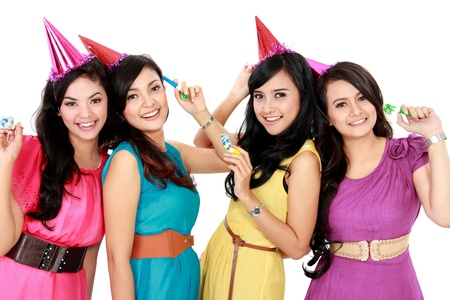 four young beautiful girls celebrate birthday isolated over white background Stock Photo