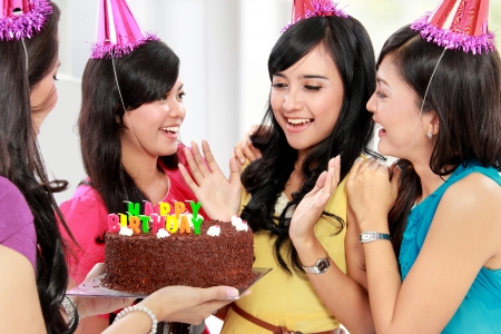 party pastries: four young beautiful woman happy celebrate birthday Stock Photo