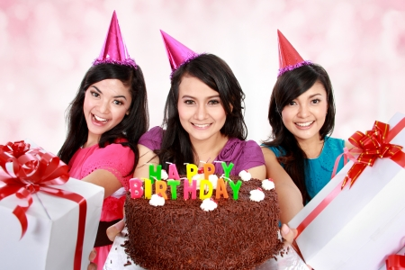 three young beautiful girls celebrate birthday photo