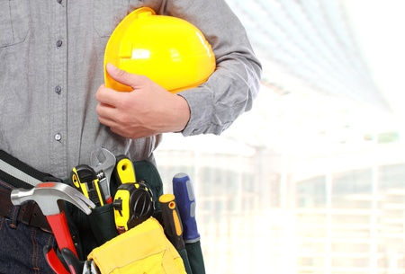 protective workwear: close up portrait of workers hand with tool and equipment