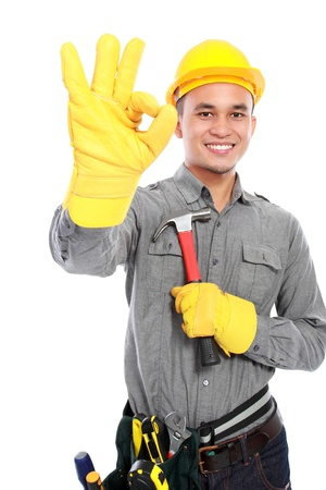 architect tools: Portrait of young worker with tool belt giving you thumbs up Stock Photo