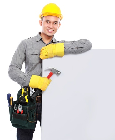 constructors: handsome worker with tool belt hold a banner