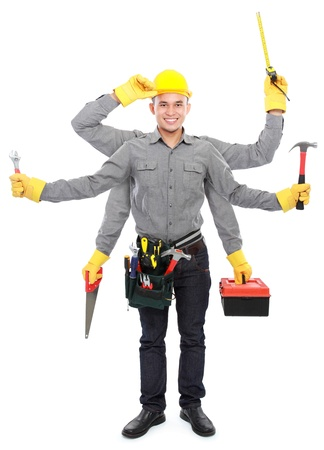 hard working people: portrait of worker use tool belt and holding equipment with six hands ready to work Stock Photo