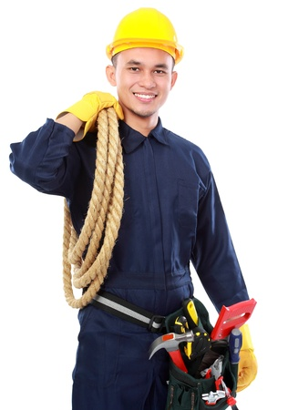 portrait of worker use blue uniform and belt tolls hold rope photo