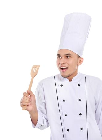 Portrait of confident male chef looking up to copy space  ready for your text Stock Photo - 17682328