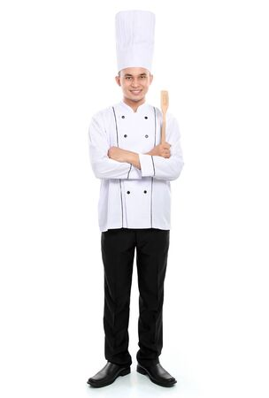 Portrait of confident male chef smiling isolated on white background photo