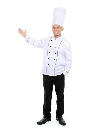 Portrait of confident male chef smiling presenting blank space for your text photo