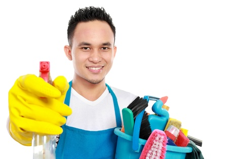 household work: portrait of man with cleaning equipment isolated over white background Stock Photo