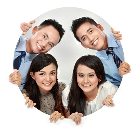 peek: Portrait of happy smiling young business team peeping through the hole Stock Photo