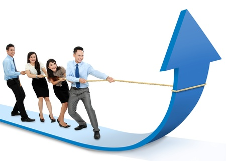 portrait of business team pulling up bar using rope. growth chart concept photo
