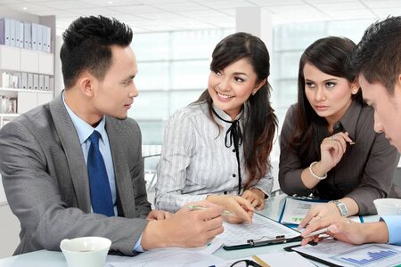 asian business team: business man and woman meeting in the office