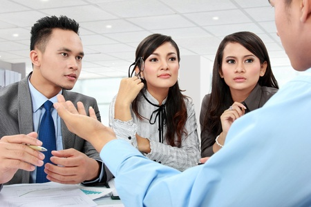 business man and woman meeting in the office with lot of paperworks Stock Photo - 17684188