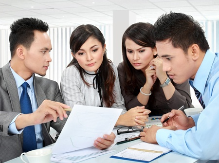 business man and woman meeting in the office with lot of paperworks Stock Photo - 17684312