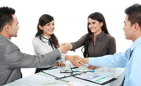 eachother: Portrait of successful business team shaking hands with eachother