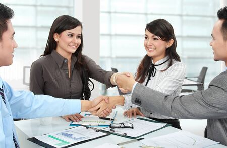 asian office lady: business man and woman meeting in the office with lot of paperworks Stock Photo