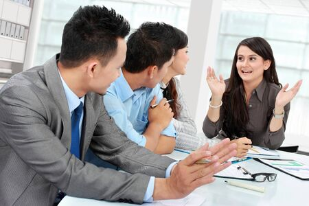 discussion group: business man and woman meeting in the office with lot of paperworks Stock Photo