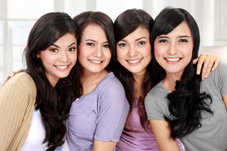 Group of beautiful asian women smiling photo