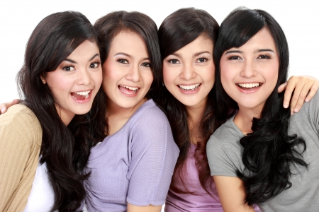 indonesian woman: Group of beautiful women smiling isolated over a white background