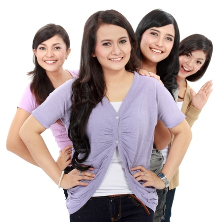 Group of beautiful women smiling isolated over a white background photo