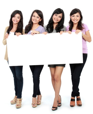 best ad: Group of beautiful women smiling with blank board