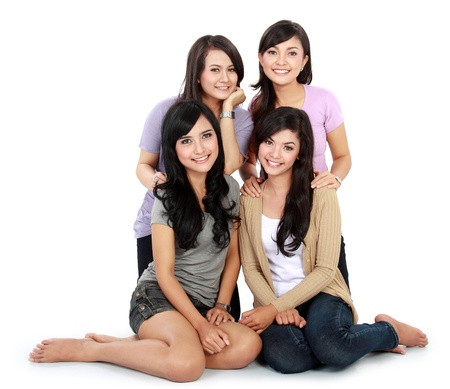 best friends: Group of beautiful women smiling isolated over a white background