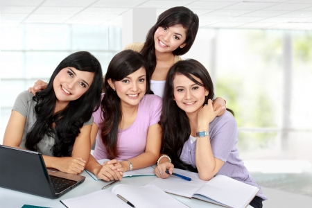 group of young woman studying together with friends photo