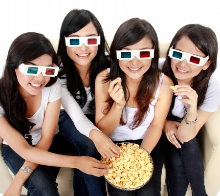 group of woman friends watching movie wearing 3d glasses photo