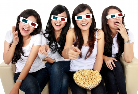 friends sitting on couch laughing at comedy movie in 3d photo