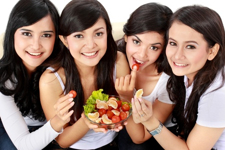 indonesian food: healthy group of attractive woman having fresh salad together Stock Photo