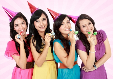 anniversary sexy: four young beautiful girls celebrate birthday isolated over white background Stock Photo
