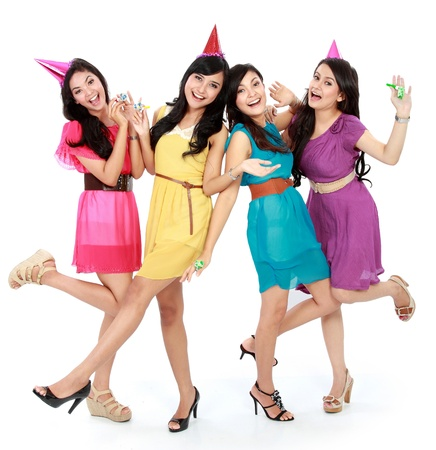 friends party: excited four young beautiful girls celebrate birthday isolated over white background