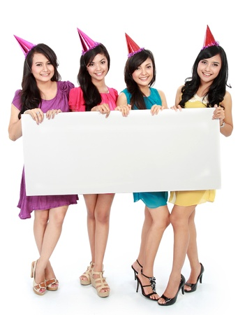 four friends: four beautiful woman holding blank board. ready for your text