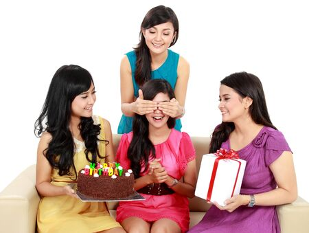 four young beautiful girls celebrate birthday isolated over white background photo